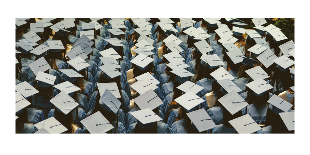 a crowd of students wearing graduation caps shot from above